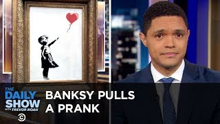 The U.N. Issues an Alarming Climate Report & Banksy Shreds His Painting | The Daily Show