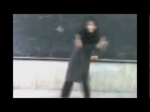 A Sexy Girl Dances In A Classroom