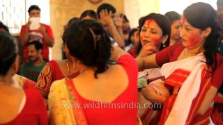 Married Indian women in ritual of Sindur khela: Kolkata Durga puja