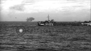 Battleships bombard island and fire on Mount Suribachi as landing craft approach ...HD Stock Footage
