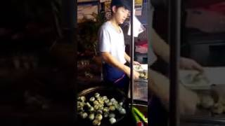 Street food in Thailand with handsome seller