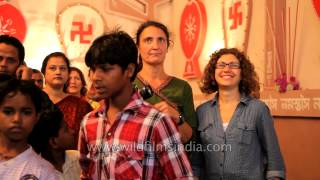 People from all around the globe visit Kolkata during Durga Puja