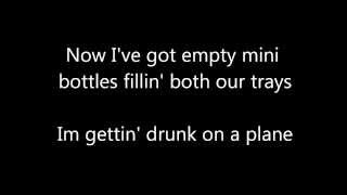 Drunk on a Plane Lyrics by Dierks Bentley
