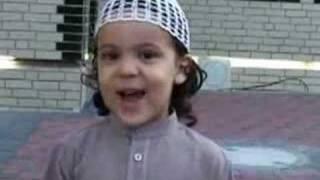 Small boy reciting Quran...