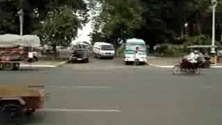 Adam Crossing The Road In Cambodia