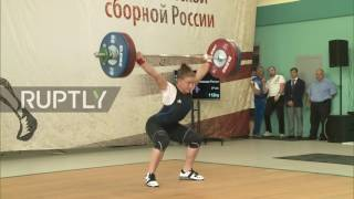 Russia: Banned weightlifters show defiance to Olympics ban with Moscow competition