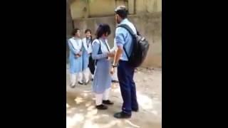 High school boy proposing a girl on street