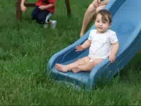 Olivia sitting on the slide
