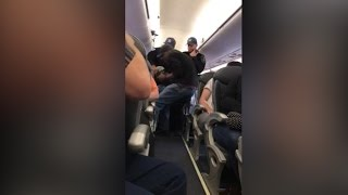 Video shows a passenger forcibly dragged off a United Airlines plane