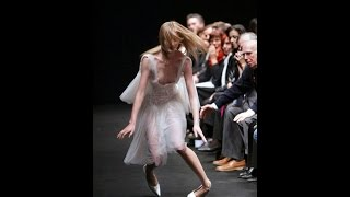 Model falls down and has a wardrobe malfunction during Coccapani Spring/Summer 2004 fashion show