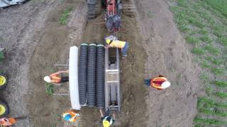 Bron plow installing ADS Dual Wall pipe