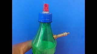 An unusual idea with a bottle and a can of spray paint..
