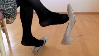 dangling with taupe high heels