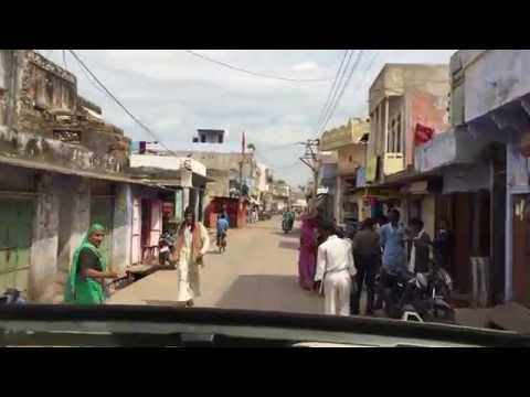 Driving through a village in India.