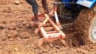 Removing stone using tractor