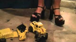 toy trucks crushed with sandals