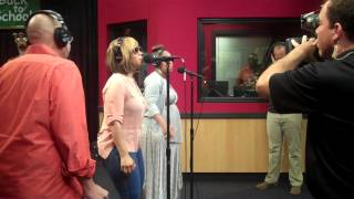 Tina and Erica of Mary Mary perform while visiting the Red Velvet Cake Studio.