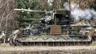 Bradley Fighting Vehicles Fire The TOW Wire Guided Missile
