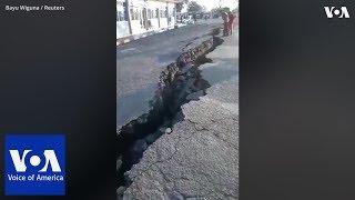 Large cracks seen on road after new earthquake strucks Lombok