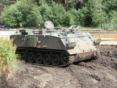 driving a FV432 armoured personnel carrier at traffic control nuenen