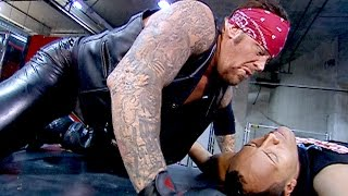 The Undertaker Tombstones The Rock onto a limo: SmackDown, Feb. 7, 2002