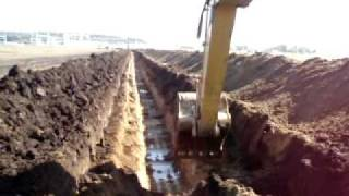 Cat 325C digging ditch