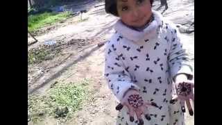 hijab with mehndi on hand.3gp