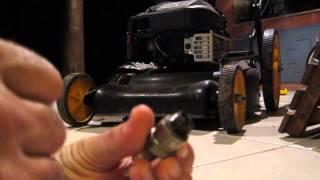 Como probar una bujia de una maquina de cortar grama