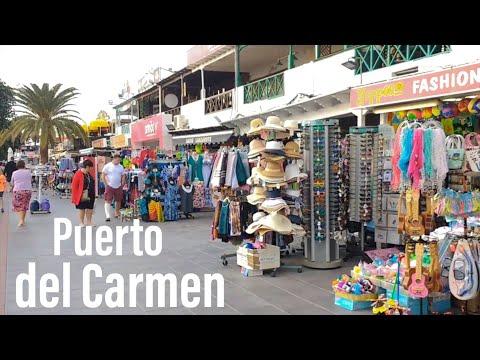 Puerto del Carmen main strip walk Lanzarote beach front from Matagorda end shops restaurants