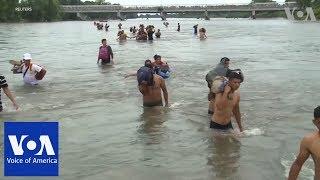 Migrants Swim, Raft Their Way Into Mexico