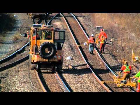 M.O.W Crews Repair and Replace Rails as Trains Pass By at The Junction HD