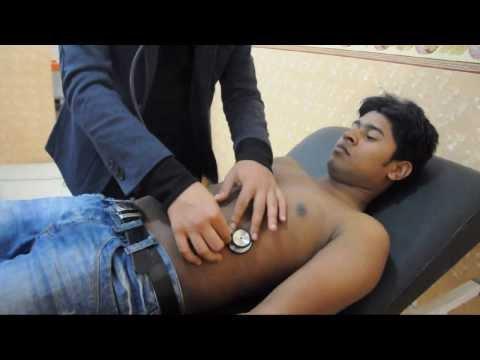 Abdominal examination by Dr. Nezar Shalaka