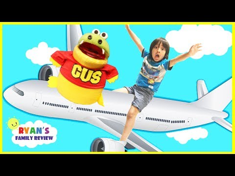 Family Fun Vacation with Ryan's Family Review! Ryan on the Airplane with GUS going to California