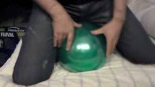 Sit pop green balloon in tight jeans