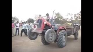 small boy driving tractor