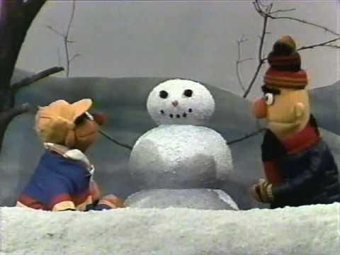Classic Sesame Street Ernie dresses a snowman