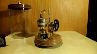 Stirling engine with musicbox in glass tube