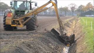 Fendt Vario 714 cleaning a ditch.