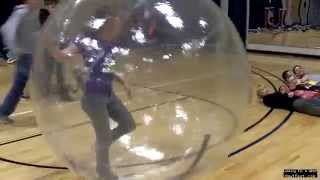 Girl in a giant Hampster ball trampling boys