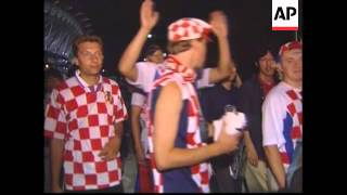 Fans react following Croatia's victory against Italy