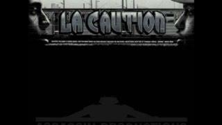 La Caution - Une Tour devant l'Arc en Ciel