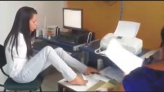 Armless girl at work