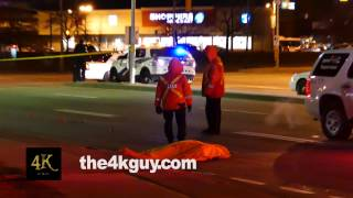 4K UHD - Traffic collision agents walking around dead body with tarp on the road