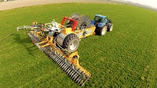 Injecting slurry using a Veenhuis Rotomax slurry reel + New Holland T7030