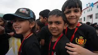 آلاف الأطفال اجتمعوا ليشكلوا بأجسادهم أكبر لوحة لصورة الشيخ زايد