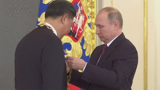 Putin presents Xi with medal as US-China tensions soar