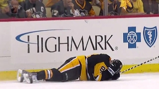 Kessel gets hit in the head with a puck by teammate