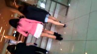 Cute girl in mini skirt