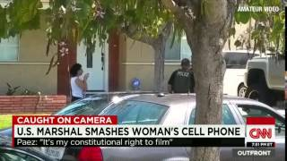 POLICE STATE - US Marshall Charges At Woman For Filming Cops Then Destroys Her Cell Phone
