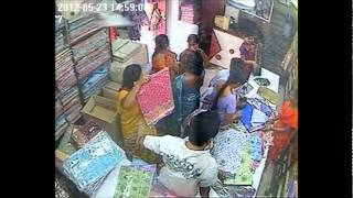Theft at a textile showroom in NELLORE